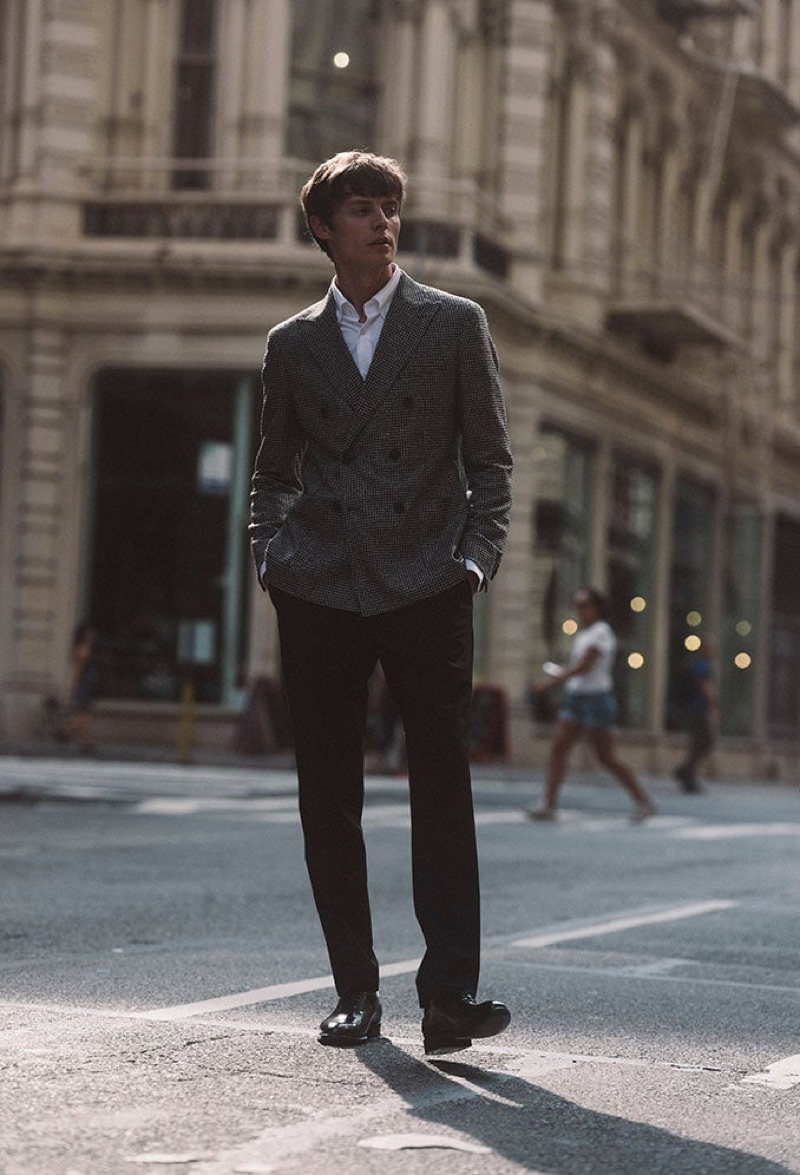 Front and center, Janis Ancens models a double-breasted jacket from Reiss.