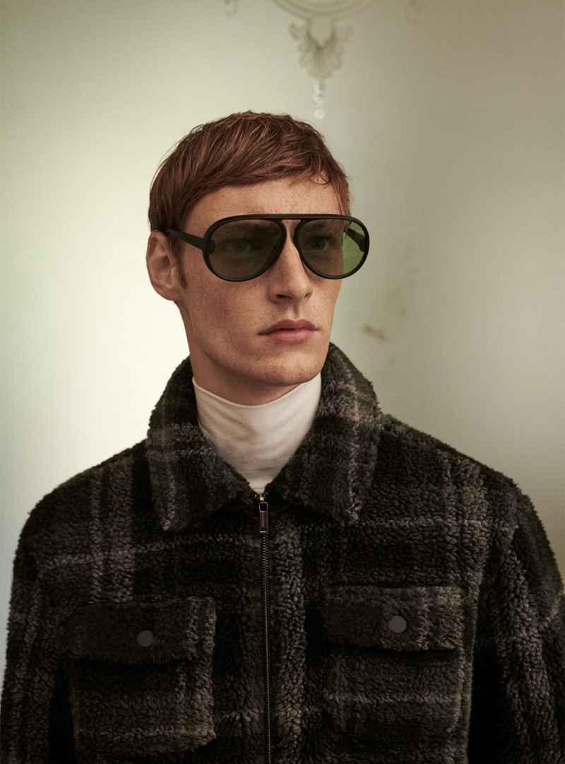 A sleek vision, Roberto Sipos sports a checked jacket from Reserved.