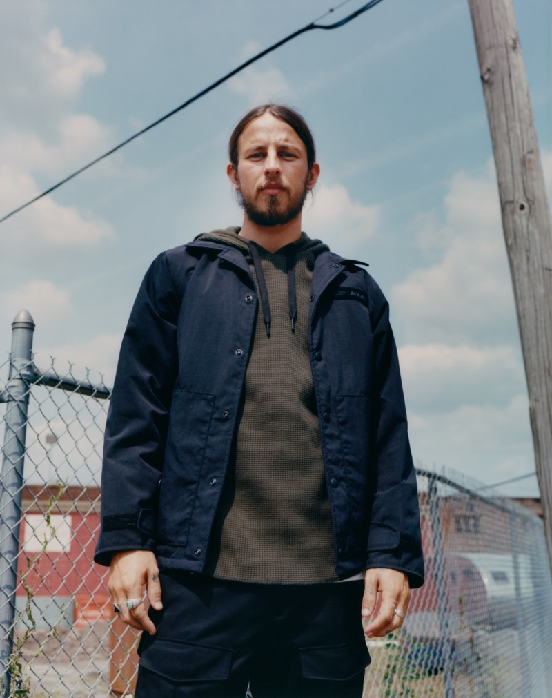 Layering, Riley Hawk wears a two-tone waffle hoodie $275 underneath a lightweight jacket.