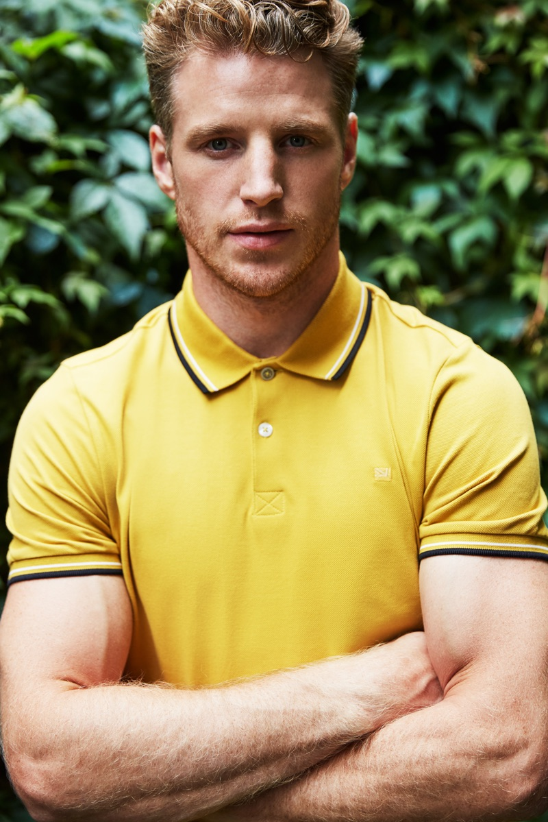 Roger Frampton dons a yellow polo shirt by Ben Sherman.
