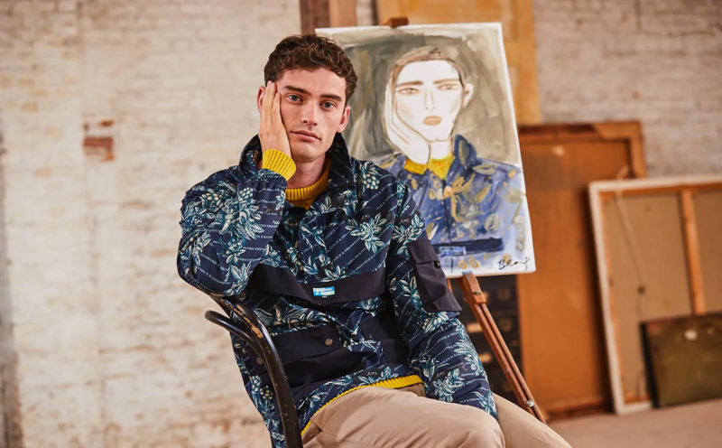 Wearing Scotch & Soda, Harrison Alexander Griffiths poses with an illustration by Blair Breitenstein.