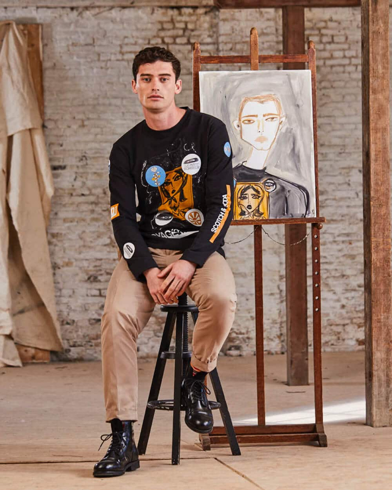 Model Harrison Griffiths sports a long-sleeve tee from Scotch & Soda's Blair Breitenstein collaboration.