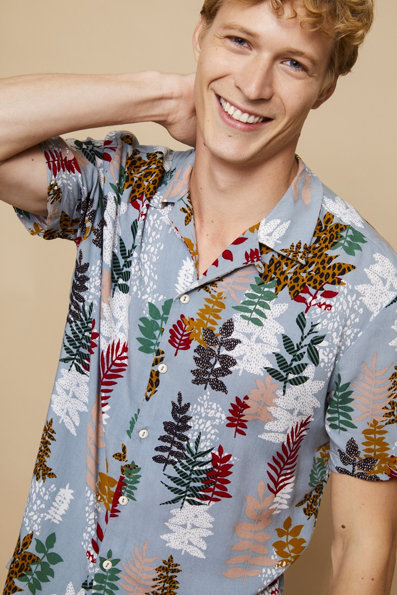 All smiles, Sven de Vries models a printed shirt from Basement.