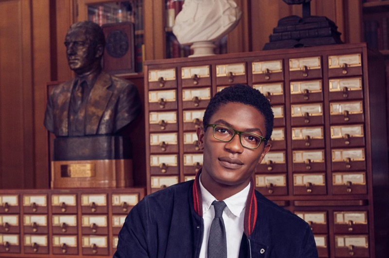 A smart vision, Hamid Onifade sports Warby Parker's Becton glasses in Rosemary Crystal.