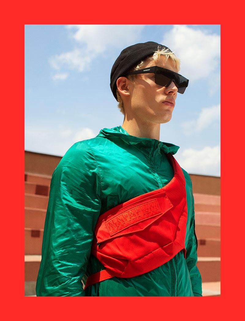 João Knorr rocks a red belt bag by Napapijri.