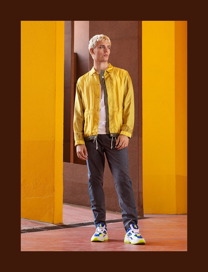 Standing out in yellow, João Knorr sports a jacket by Sacai.