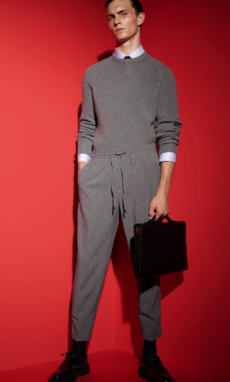 Embracing a monochromatic grey number, Luc Defont-Saviard wears a look from Zara Man's traveler collection.