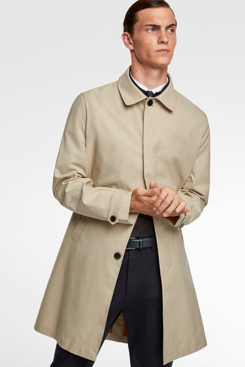 Wearing a smart trench, Luc Defont-Saviard highlights standout styles from Zara Man's traveler collection.