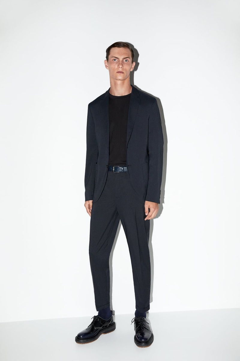 A smart vision, Luc Defont-Saviard dons a suit from Zara Man's traveler collection.