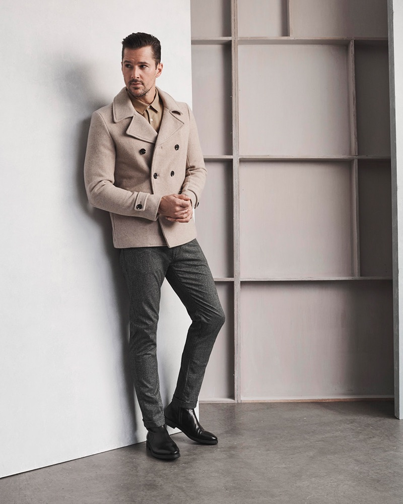 Model Andrew Shaw wears 34 Heritage's Cool mid-rise, slim leg grey checked pants.