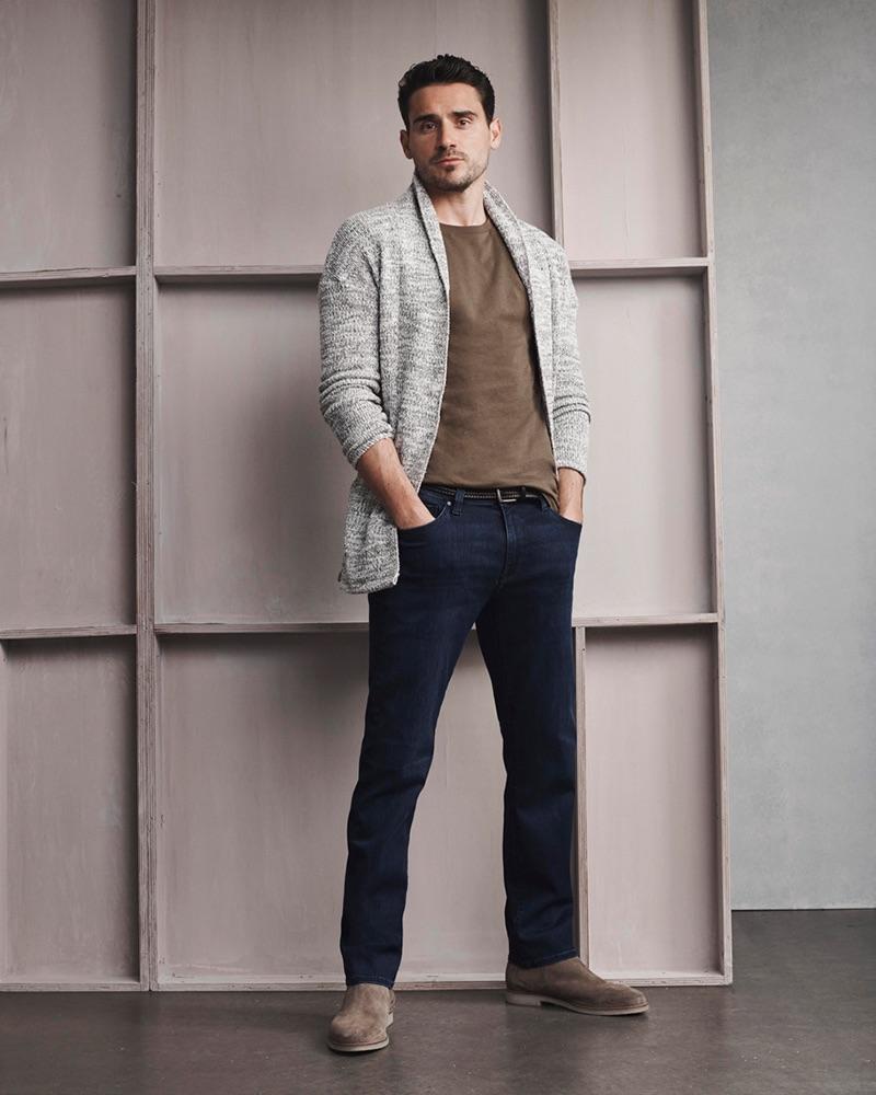 Arthur Kulkov wears 34 Heritage's Courage mid-rise, straight leg deep brushed jeans.