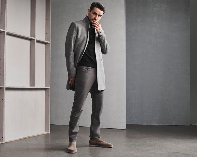 Front and center, Arthur Kulkov sports 34 Heritage's Courage mid-rise, straight graphite commuter pants.