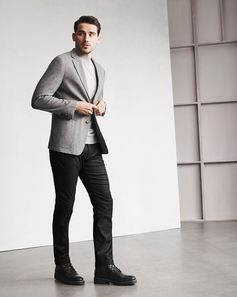 A smart vision, Arthur Kulkov rocks 34 Heritage's Courage mid-rise, straight leg black checked pants.