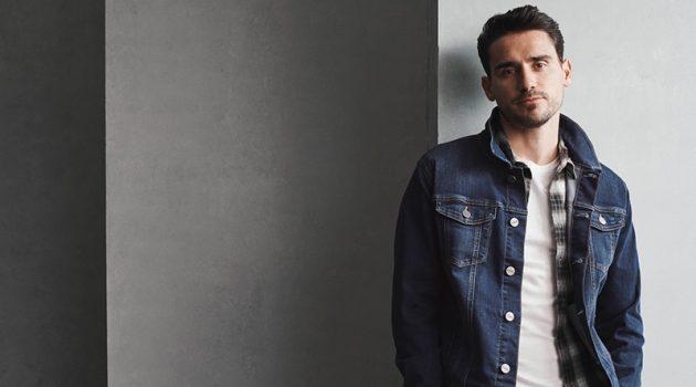 Top model Arthur Kulkov wears 34 Heritage's Travis denim jean jacket.