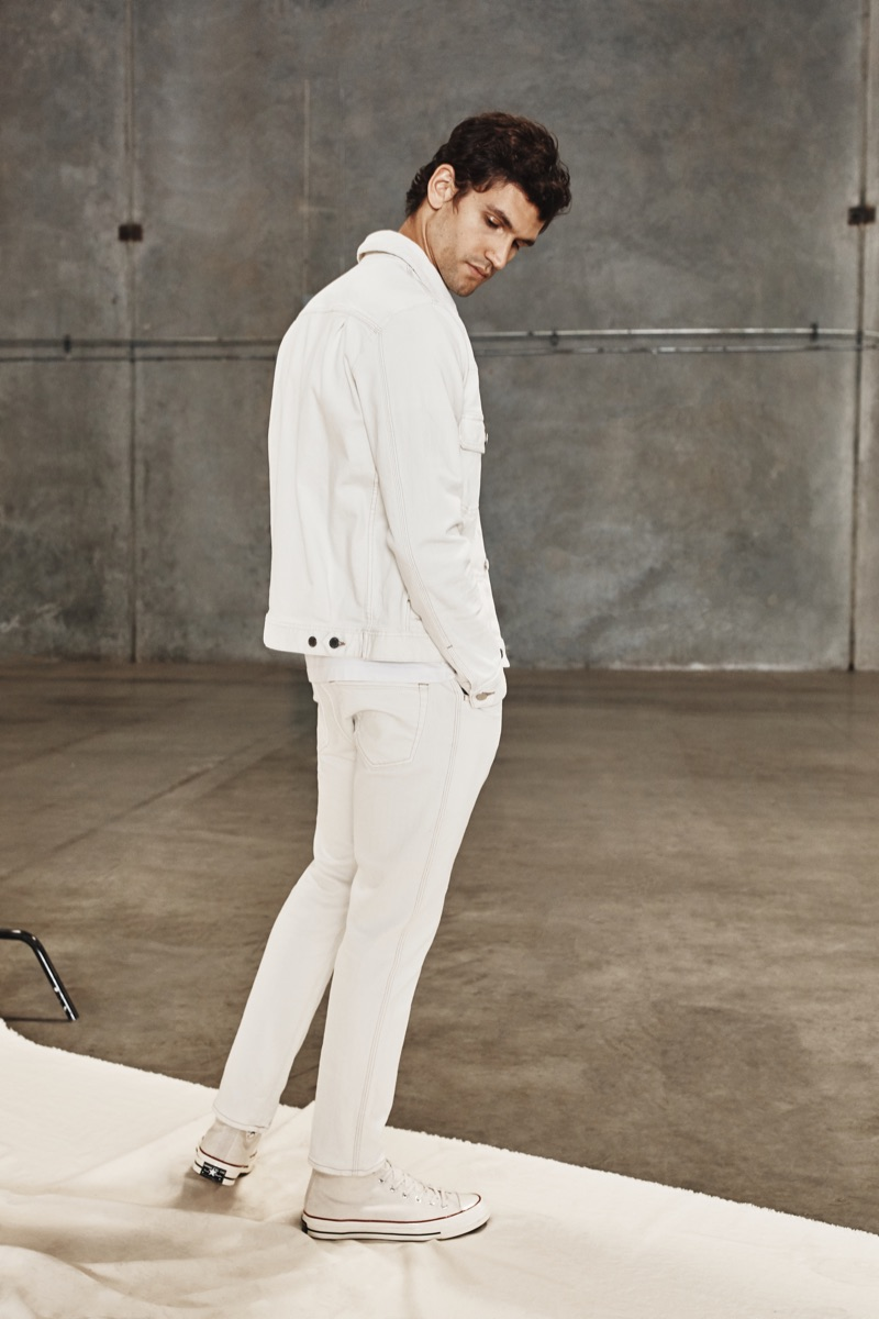 Making a case for white, Alfredo Nemer wears denim from AG Jeans' spring-summer 2020 collection.