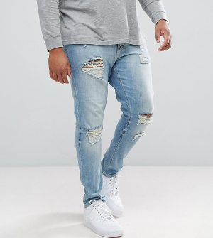 ASOS DESIGN Plus skinny jeans in light wash with heavy rips - Blue