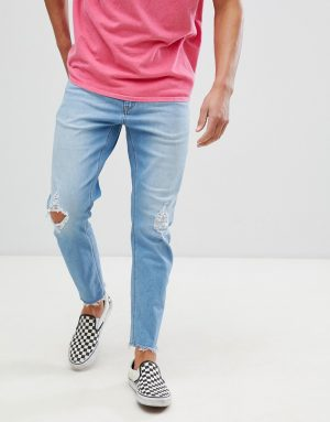 ASOS DESIGN tapered jeans in vintage light wash with rips - Blue