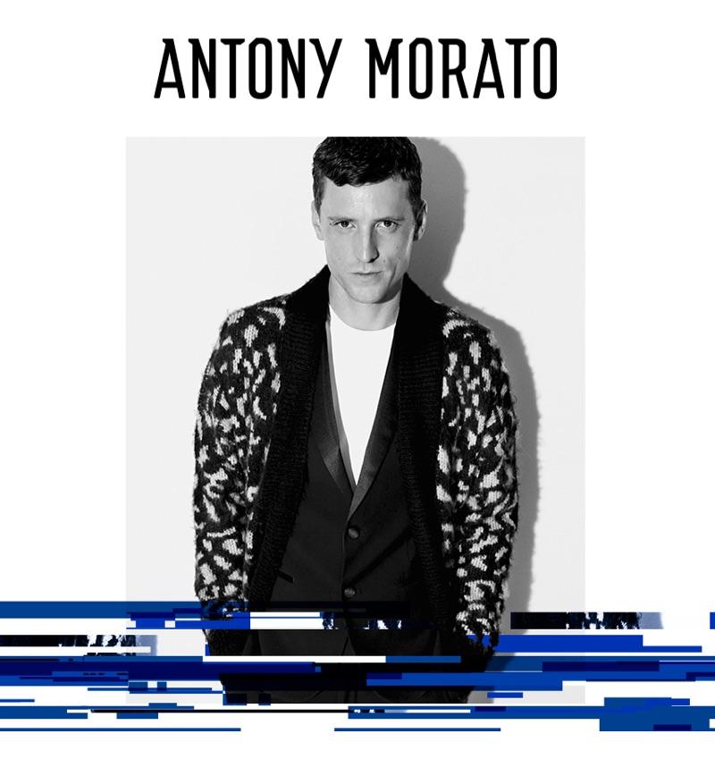 Model George Barnett wears a tuxedo and knit cardigan for Antony Morato's fall-winter 2019 campaign.