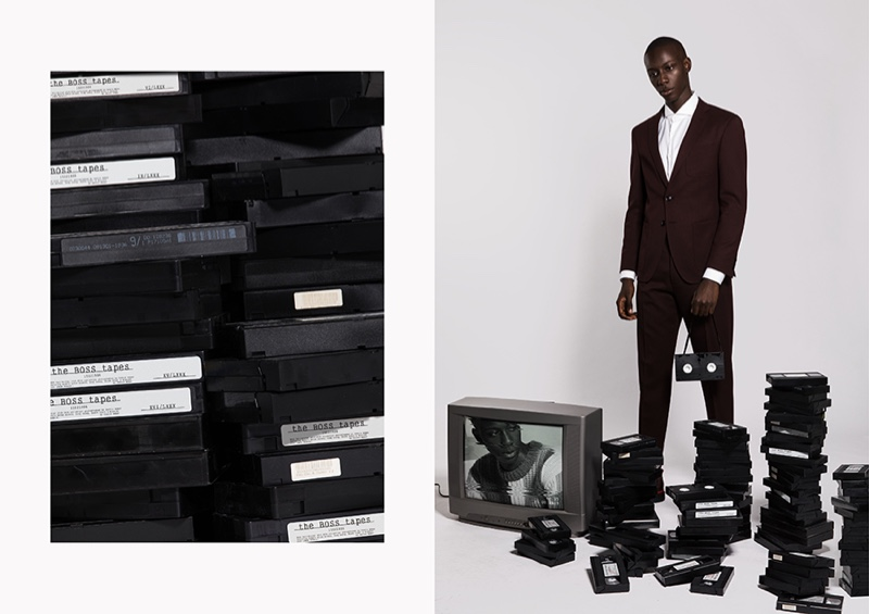Enoch is a sharp vision in an elegant BOSS suit with a white shirt.