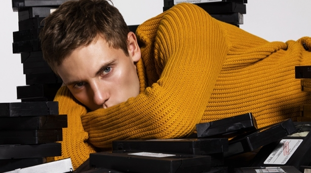 Embracing a pop of color, Anton wears a ribbed sweater from BOSS.