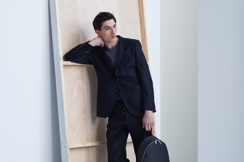 Jester White poses in a black suit from BOSS' Traceable Wool men's capsule collection.