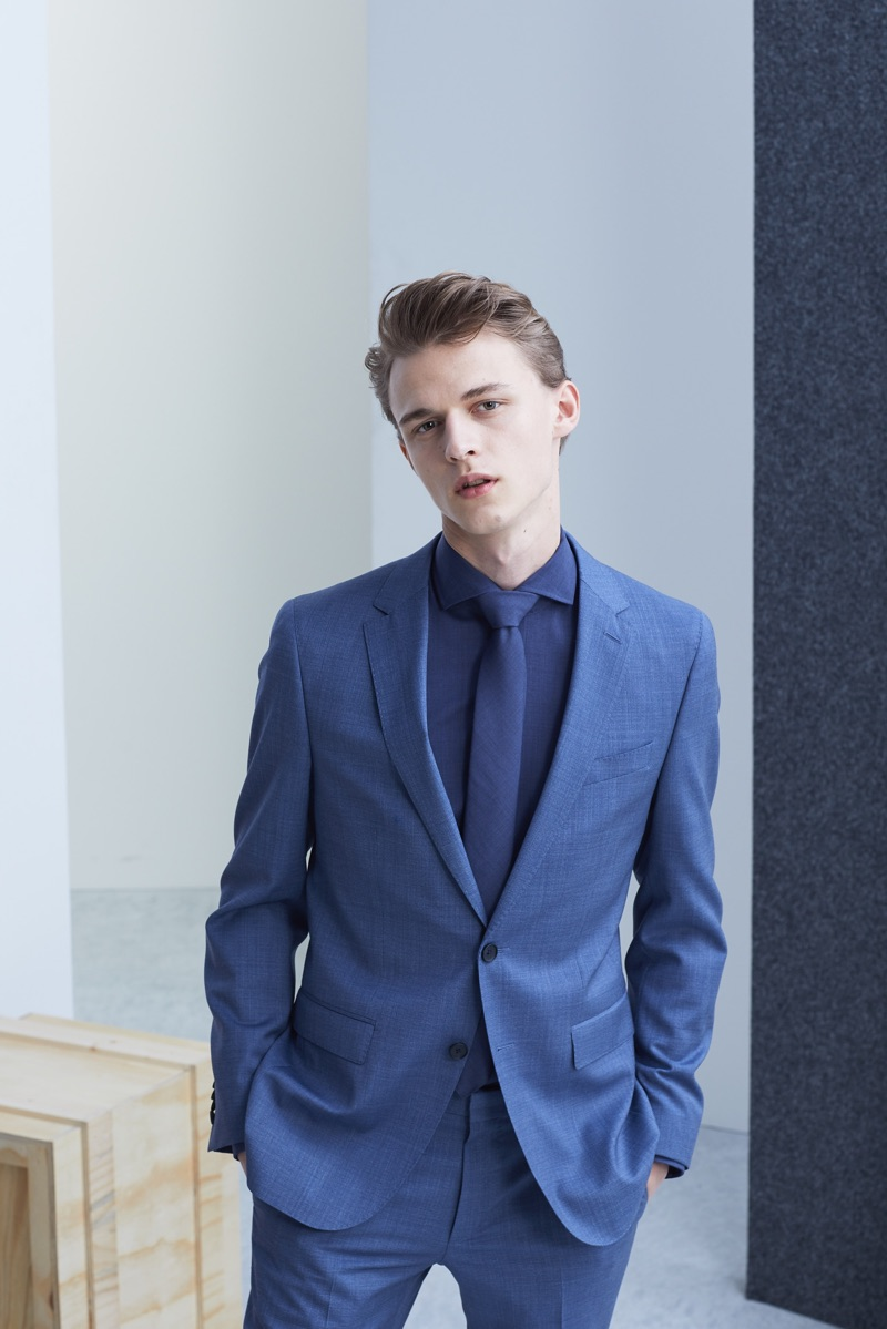 Max Barczak dons an elegant two-button suit, shirt, and tie from BOSS' Traceable Wool men's capsule collection.