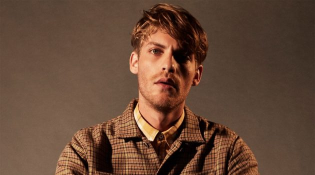 Front and center, Baptiste Radufe dons a checked overshirt with corduroy pants by Zara.
