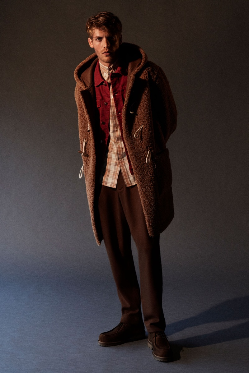 Taking to the studio, Baptiste Radufe models fall fashions from Zara.