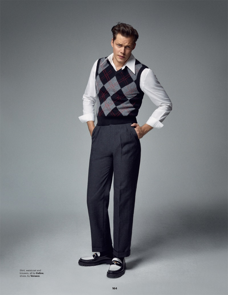 Channeling a retro attitude, Bill Skarsgård wears a look by Celine with Versace shoes.