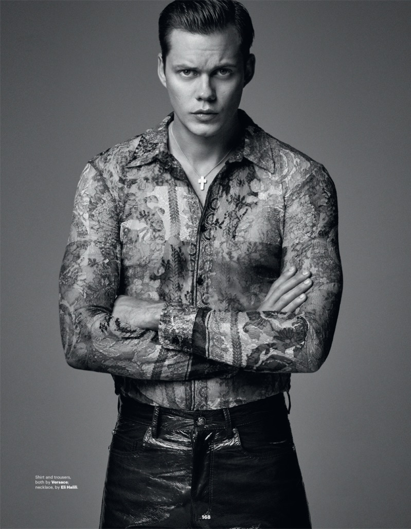 Front and center, Bill Skarsgård wears a shirt and pants by Versace.
