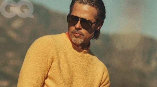 Standing out in yellow, Brad Pitt dons a Holiday Boileau sweater with a Boglioli shirt. Pitt also rocks Levi's Authorized Vintage jeans with an Artemas Quibble belt, vintage Ray-Ban sunglasses, and a David Yurman ring.