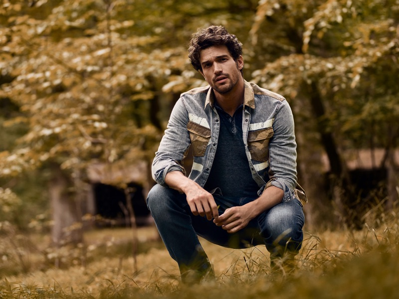 Sporting denim and camouflage, Paul Kelly fronts Buffalo David Bitton's fall-winter 2019 campaign.