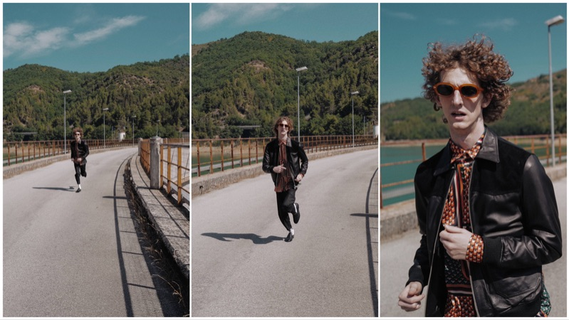 On the move, Alexiey Barbaro dons a leather jacket and printed shirt by C.9.3.
