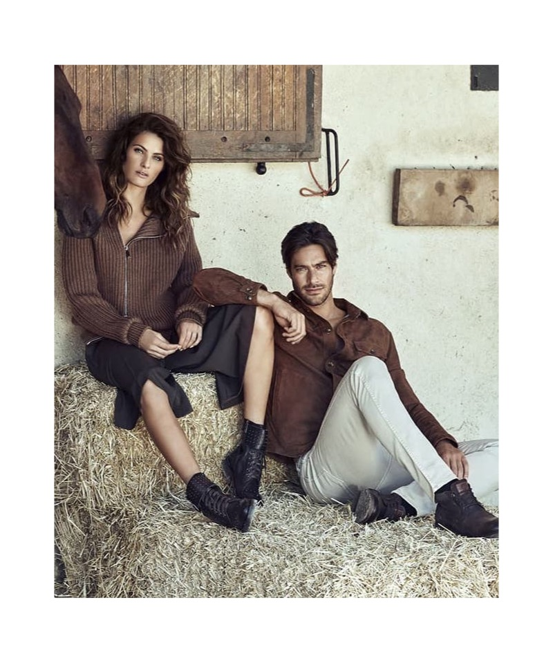 Donning a wardrobe with earth tones, Isabeli Fontana and Gonçalo Teixeira appear in Carmela Shoes' fall-winter 2019 campaign.