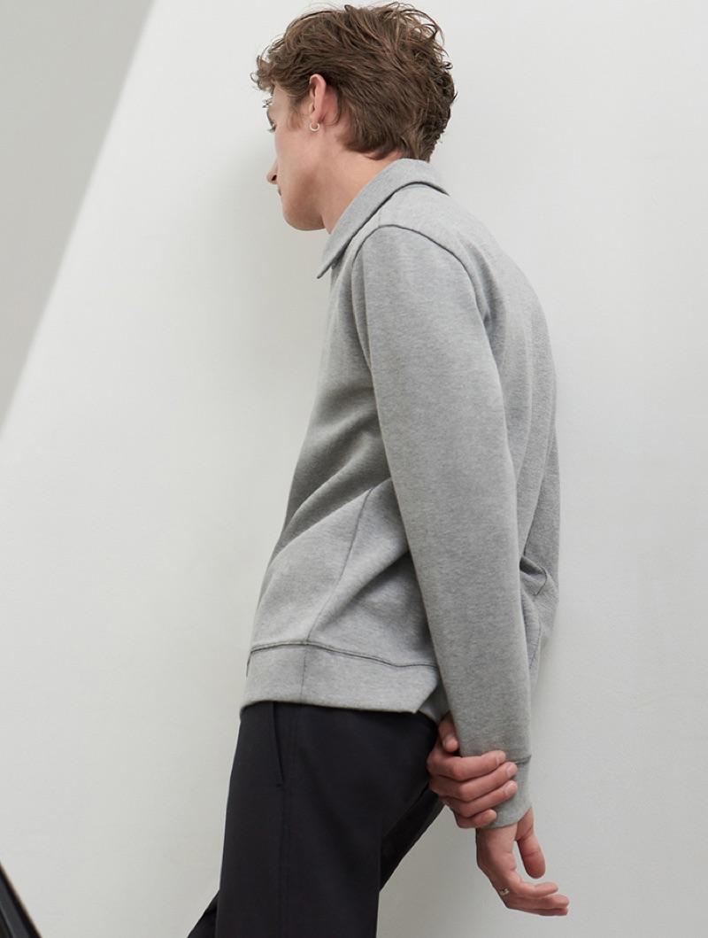 Donning fall fashions, Janis Ancens wears a grey Club Monaco zip mock sweatshirt.