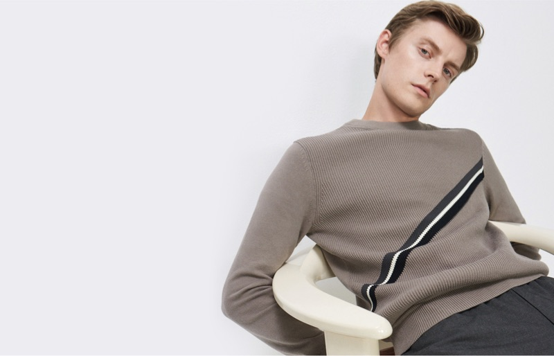 Janis Ancens sports a diagonal stripe sweater $149.50 from Club Monaco.