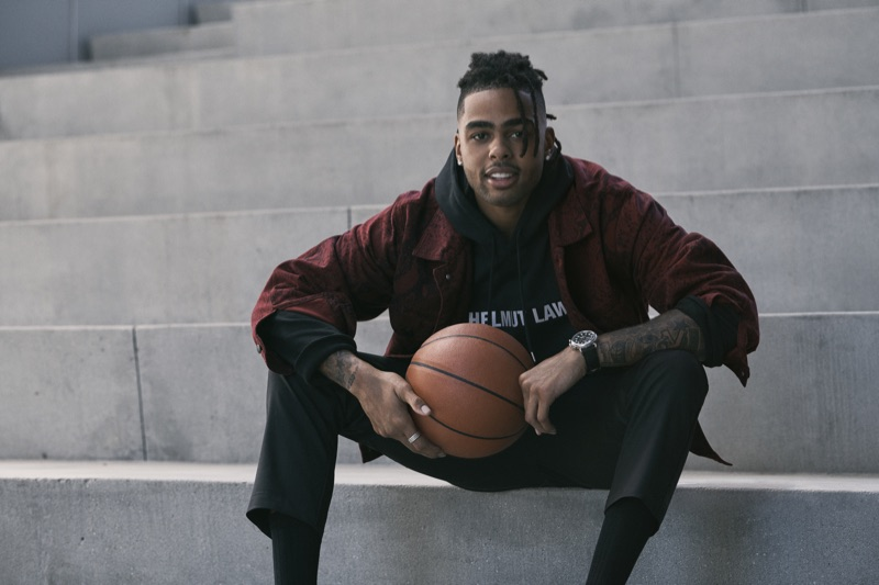 D'Angelo Russell sports an Alexander Wang red snake print denim jacket with a Helmut Lang hoodie, Barena cargo pants, and a Shinola watch for Bloomingdale's fall 2019 Mix Masters campaign.