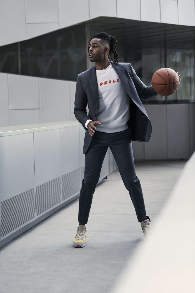 Connecting with Bloomingdale's, D'Angelo Russell wears a Theory suit with an A.P.C. graphic sweatshirt.