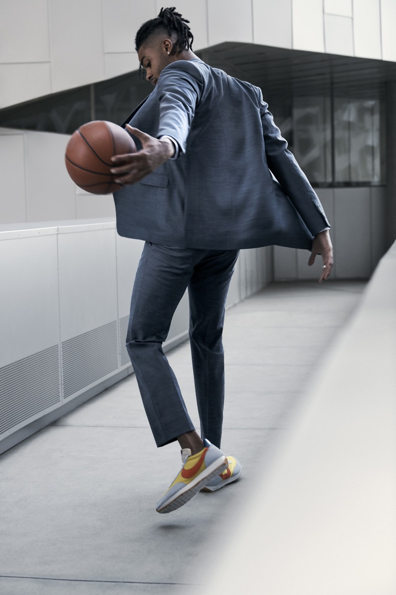 Dribbling a basketball, D'Angelo Russell dons a Theory suit.