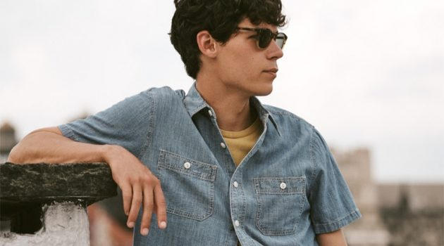 Going simple, Tyler Blue Golden rocks a Madewell chambray shirt and t-shirt with Oliver Peoples Finley Esquire sunglasses.