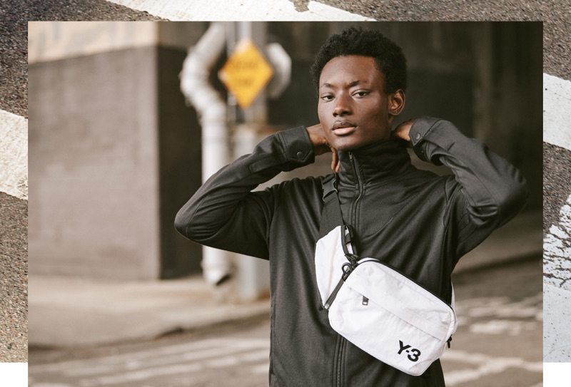 Reuniting with East Dane, Youssouf Bamba sports a Y-3 track jacket, cropped pants, and sling bag.