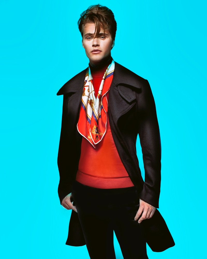 Konrad wears red turtleneck Simons, trench Dsquared2, pants Paul Smith, scarf Christian Dior, and watch Michael Kors.