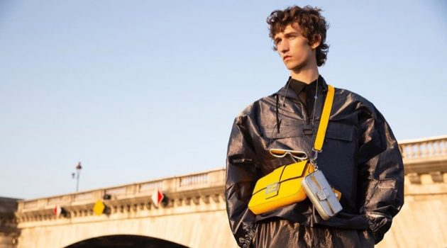Etienne de Testa sports Fendi's leather Baguette bag in yellow.