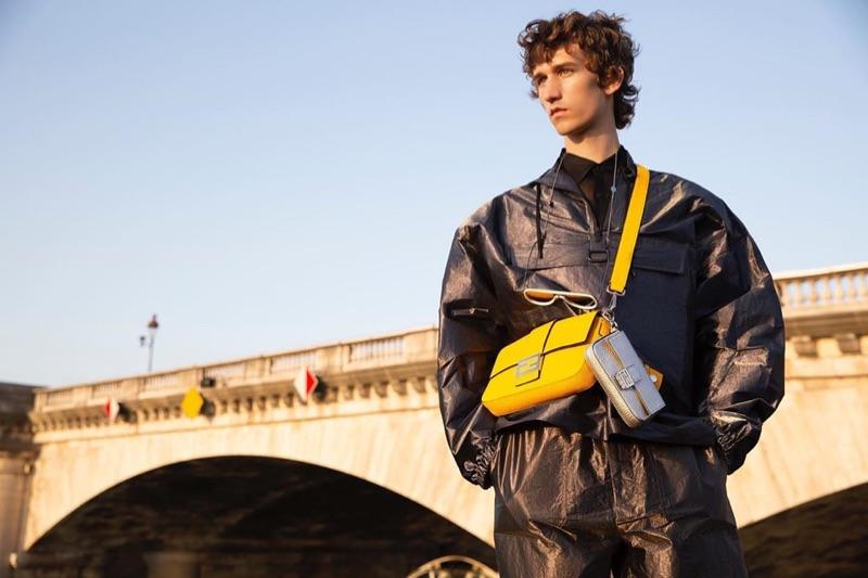 Etienne de Testa sports Fendi's leather Baguette bag in yellow.
