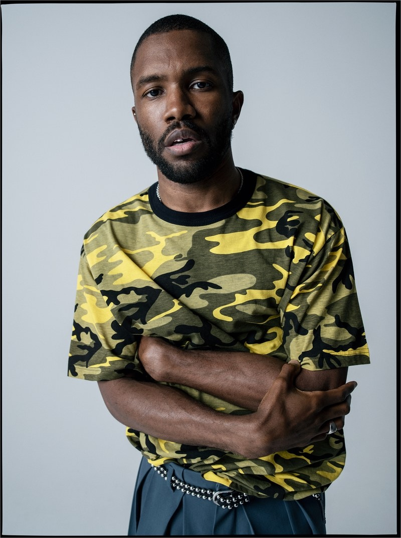 Front and center, Frank Ocean wears his own camouflage print t-shirt with a Louis Vuitton shorts skirt and vintage belt.