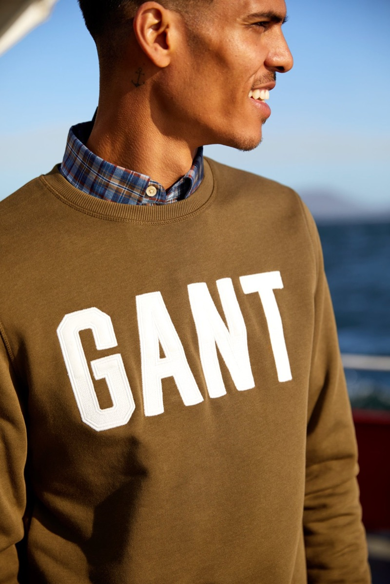 Sporting a Gant pullover, Geron McKinley fronts the brand's fall 2019 campaign.