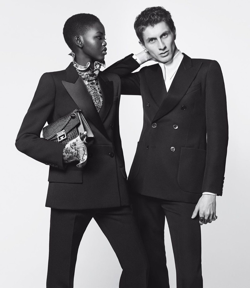 """Adut Akech and Henry Kitcher don elegant tuxedos for Givenchy's 2019 """"Winter of Eden"""" campaign."""