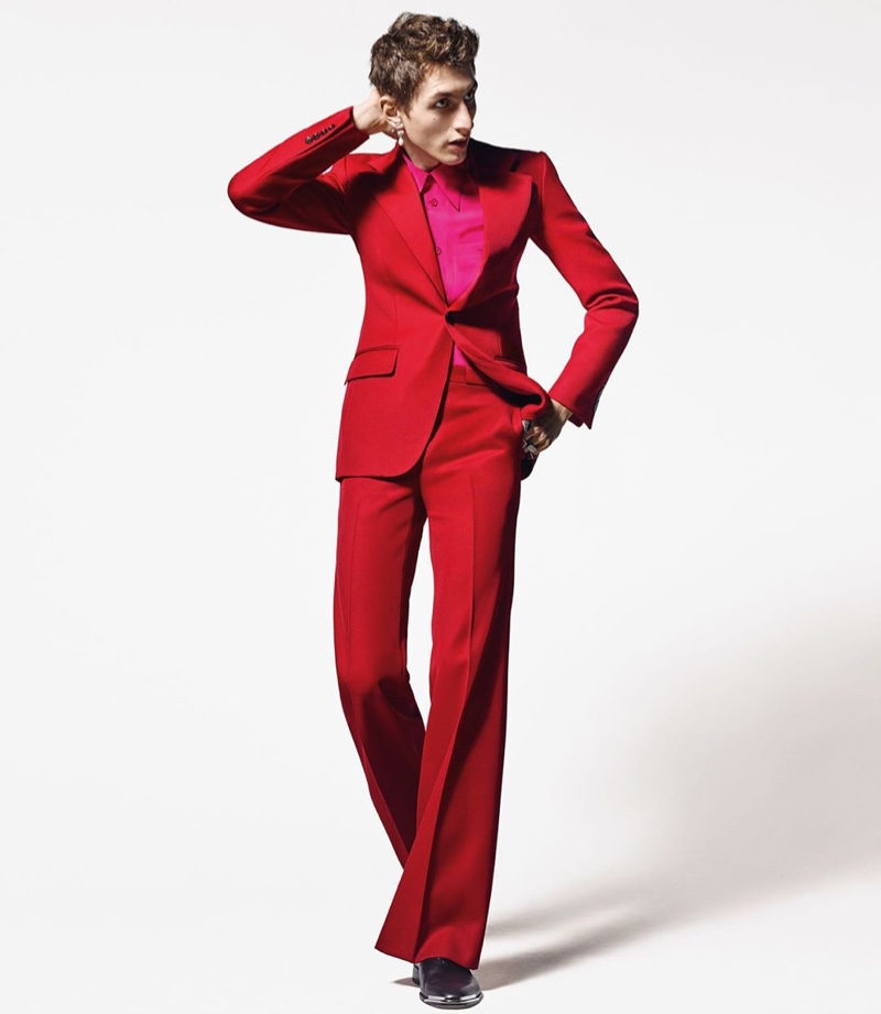 Model Henry Kitcher is striking in a red suit for Givenchy's 2019 'Winter of Eden' campaign.