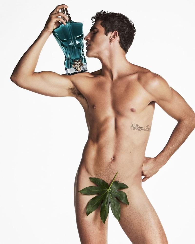 Brazilian model Jhonattan Burjack poses naked with a bottle of Jean Paul Gaultier's Le Beau.