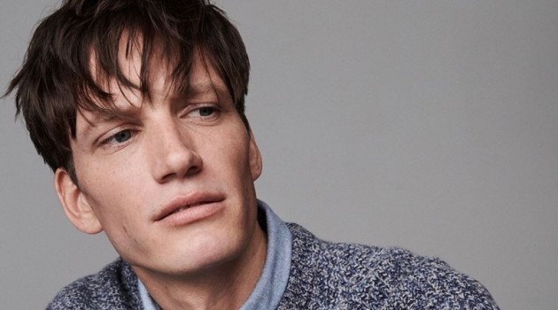 Florian Van Bael dons a smart shirt and sweater from Jigsaw's fall-winter 2019 men's collection.